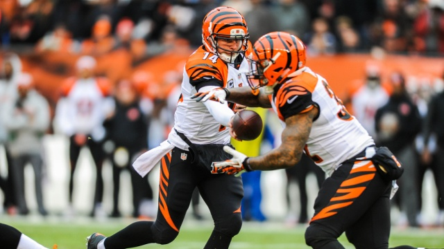 Andy Dalton hands the ball off to Jeremy Hill (Photo Courtesy of Ken Blaze/USA TODAY Sports)