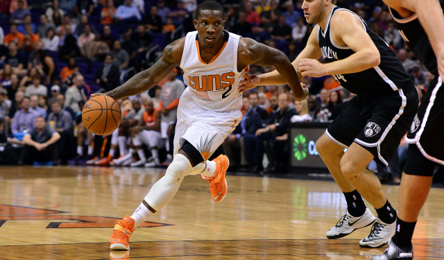 Nov 12, 2014; Phoenix, AZ, USA; Phoenix Suns guard Eric Bledsoe (2) handles the basketball against the Brooklyn Nets guard Bojan Bogdanovic (44) in the second half at US Airways Center. The Suns won 112-104. Mandatory Credit: Jennifer Stewart-USA TODAY Sports