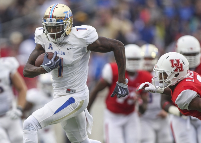 Nov 22, 2014; Houston, TX, USA; Tulsa Golden Hurricane wide receiver Keyarris Garrett (1) makes a reception during the second quarter against the Houston Cougars at TDECU Stadium. Mandatory Credit: Troy Taormina-USA TODAY Sports