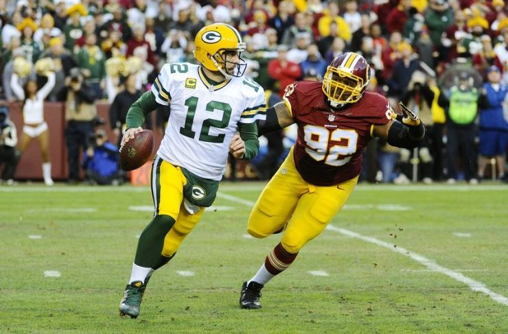 Aaron Rodgers rolls out against Washington (Photo Courtesy of Brad Mills/USA TODAY Sports)