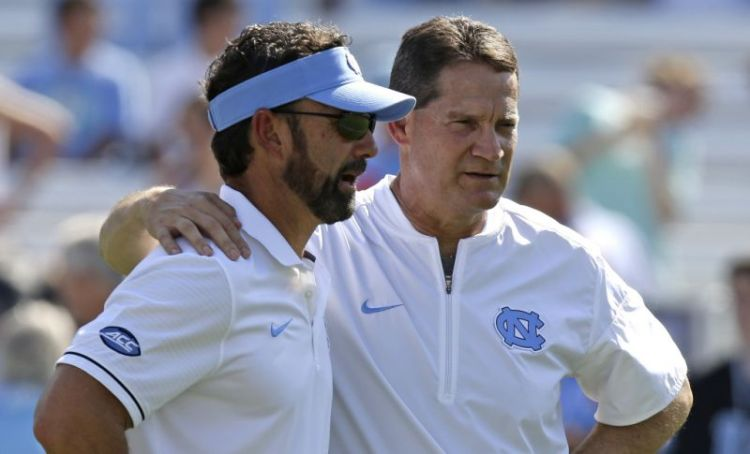 Larry Fedora and Gene Chizik (AP)